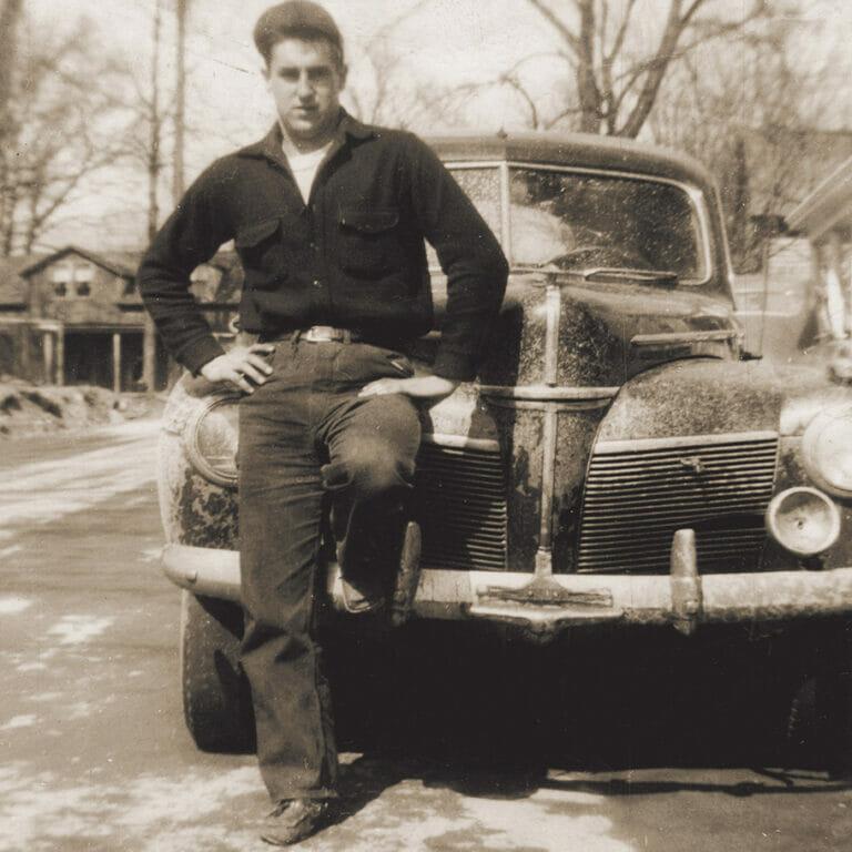 joseph carr standing by car