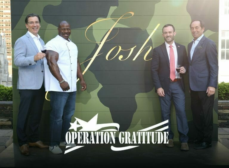 chef with Joseph car in front of operation gratitude sign
